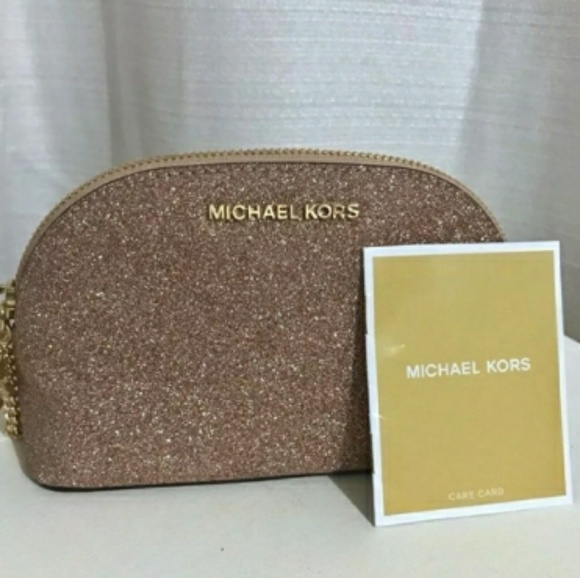 795a00b5cdda Michael Kors Rose Gold Alex Glitter Makeup Bag. M_5a75b5169d20f02451f267b9